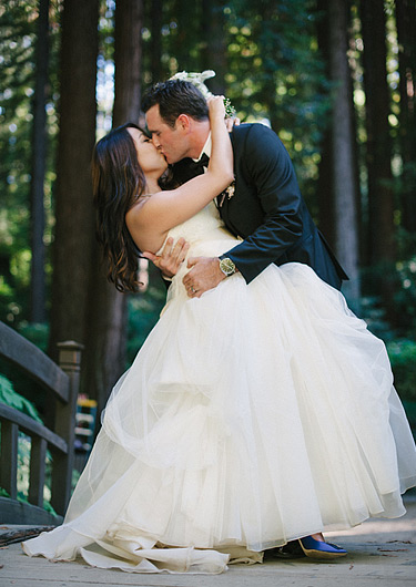 Bride and Groom kissing on the bridge at Nestldown Los Gatos