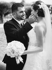Balck and white photo of groom caressing the bride's face