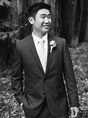 black and white photo of groom