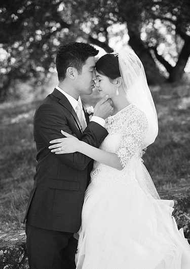 Black and white picture of bride and groom in an embrace