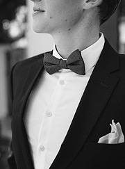 Close up of the groom's jacket and bowtie
