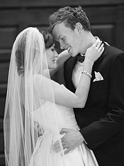 Romantic black and white photo of bride and groom caressing and hugging