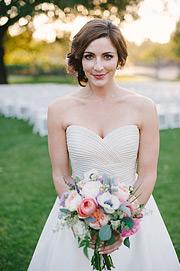 Portrait of the bride holding the bouquet