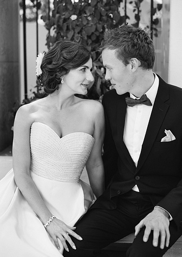 Black and white photos of bride and groom leaning close to each other