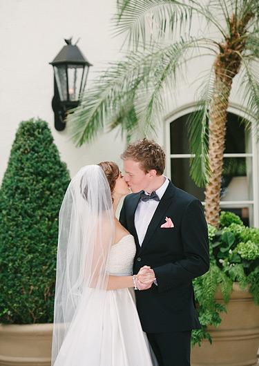 Bride and groom kissing at Menlo Circus Club
