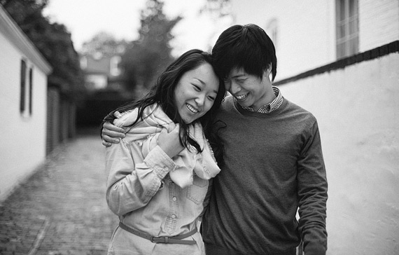 Couple walking and hugging each other. Old Town Alexandria engagement photos.