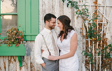 Wedding photos of bride and groom with old barn in the background at Annadel Estate Winery in Santa Rosa