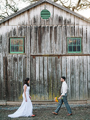 Bride and groom walking toward each other in front of the barn at Annadel Estate Winery in Santa Rosa