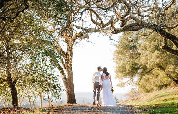 Bride and Groom kissing in the midst of the trees at Annadel Estate Winery in Santa Rosa