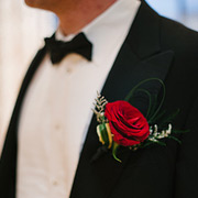 Red rose as groom's boutonniere