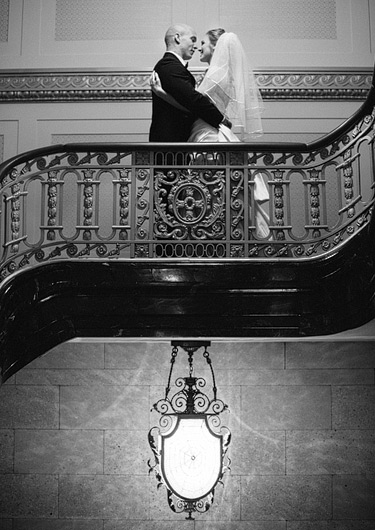 Bride and groom on the staircase at Westin St. Francis in Union Square