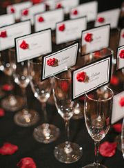 Detail of escort cards on champagne glasses