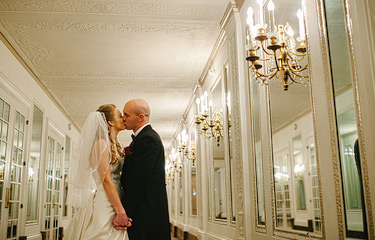 Bride and groom kissing on the mezzanine floor of Westin St. Francis hotel