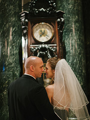 Wedding photos in front of the grandfather clock at Westin St. Francis hotel