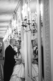 Bride and groom's reflection in the mirror at Westin St. Francis hotel in San Francisco