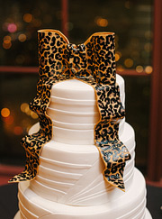 Wedding cake with a bow of leopard print topper