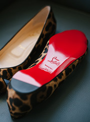 Red sole of the Christian Louboutin shoes. Leopard print shoes.
