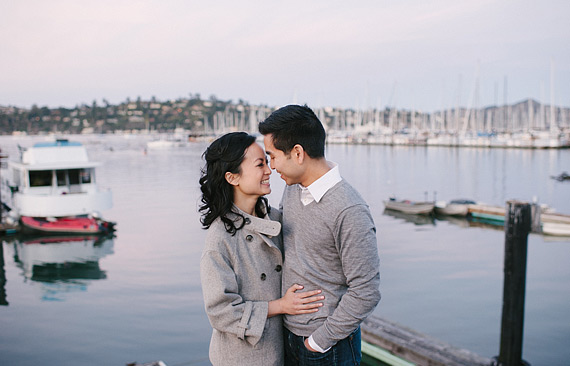 Couple laughing with San Francisco bay in the background. Engagement photos in Sausalito, CA