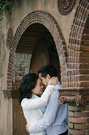 Couple huggin inside of an archway in Sausalito. Engagement portrait photos