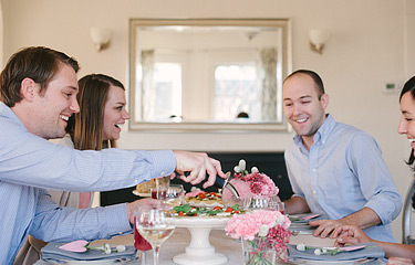Two couples enjoying a meal together during Valentine's Day dinner party