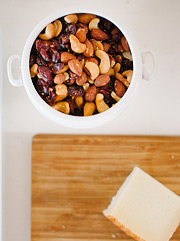 Bowl of nuts and cheese board