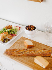 Cheese, baguette, nuts and grapes with meats