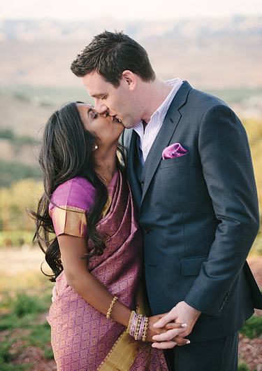 Bride and groom kissing. Multicultural wedding