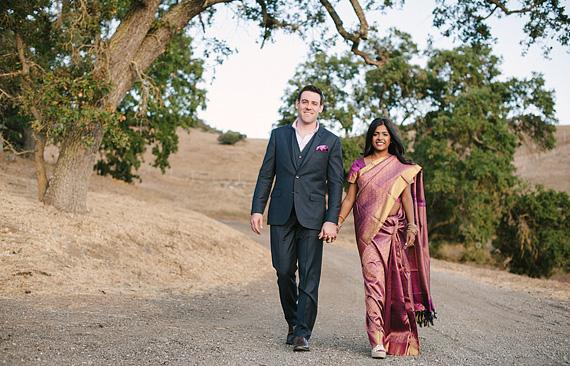 Bride and groom walking. Multicultural wedding.