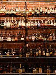 Wall of whiskeys at Multnomah Whiskey Library