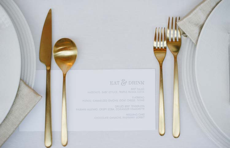 Gold knife, spoon and forks for a white inspired wedding