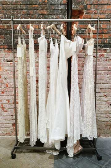 Beautiful BHLDN dresses hang on a garment rack