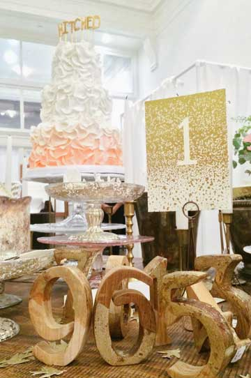 Gold Teak Wood Table Numbers, cake and printed materials at BHLDN