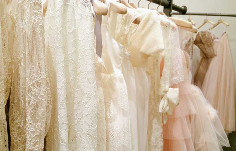 BHLDN wedding dresses on hanging on a garment rack in San Francisco Firehouse 8