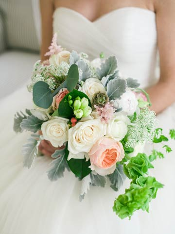 Bride holding her bouquet of flowers. Simple and elegant.
