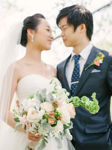 Bride and groom with beautiful pastel florals.