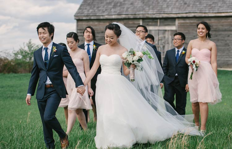 Wedding party walking in front of a barn. Maryland wedding photography.