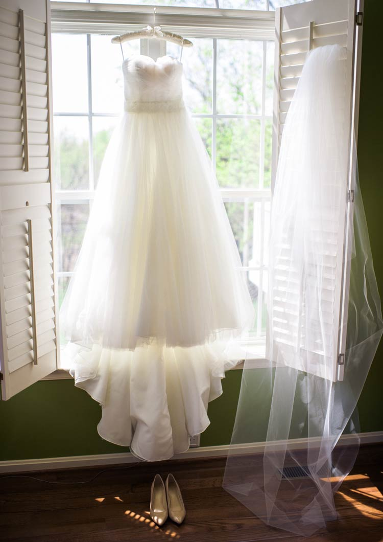 Wedding details: gown, veil and shoes. Elegant wedding photography