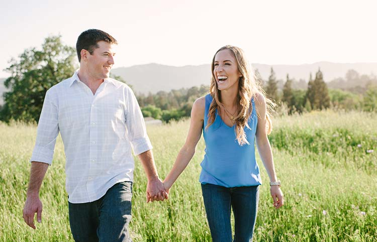 Couple walking together laughing. Engagement photos in SF East Bay