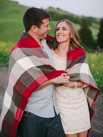 Couple wrapped in a blanket together. Lifestyle editorial engagement photos.
