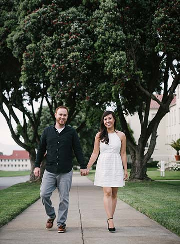 Engaged couple walking holding hands. Lifestyle SF photography