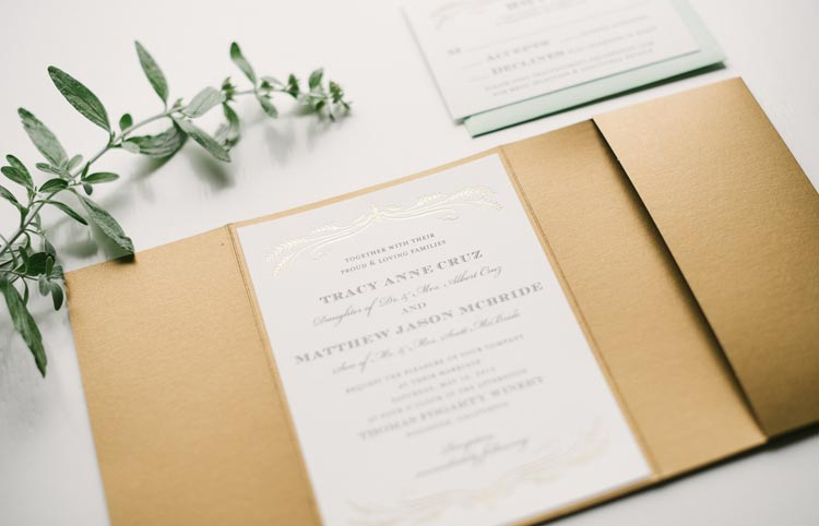 Gold, earthy and green wedding invitation design