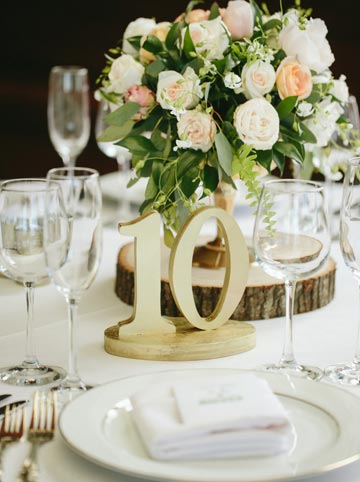 Gold, gree, blush pink and peach table setting arrangement