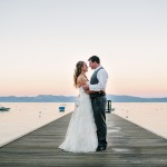 Bride and groom on the dock in Lake Tahoe. Wedding photography by Pictilio.