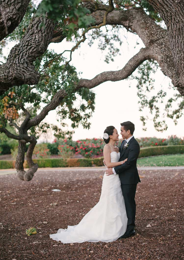 Portrait of Bride and Groom underneath a large oak tree at Ruby Hill Golf Club