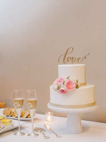 Wedding cake with word Love as a cake topper