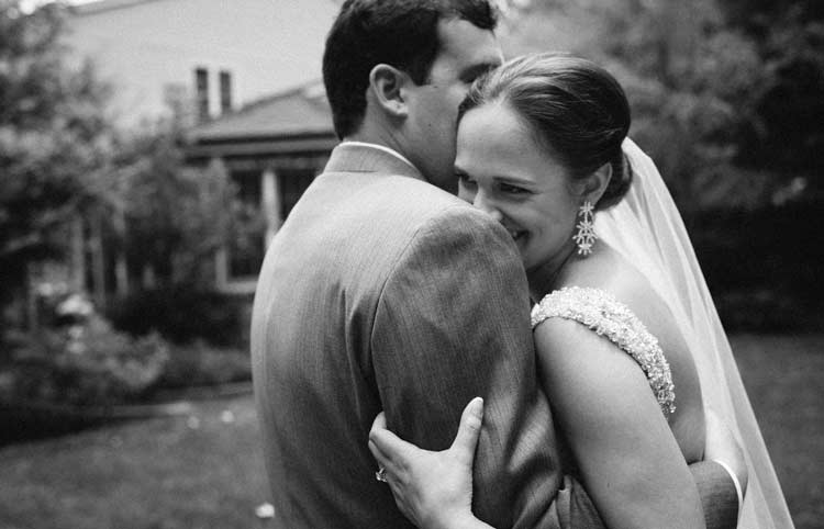Real emotions, bride and groom laughing