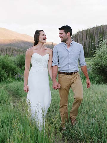 Colorado wedding - portrait of bride and groom walking in the mountains