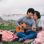 Enjoying the sunset on a blanket with guitar. Old Town Alexandria engagement photos.